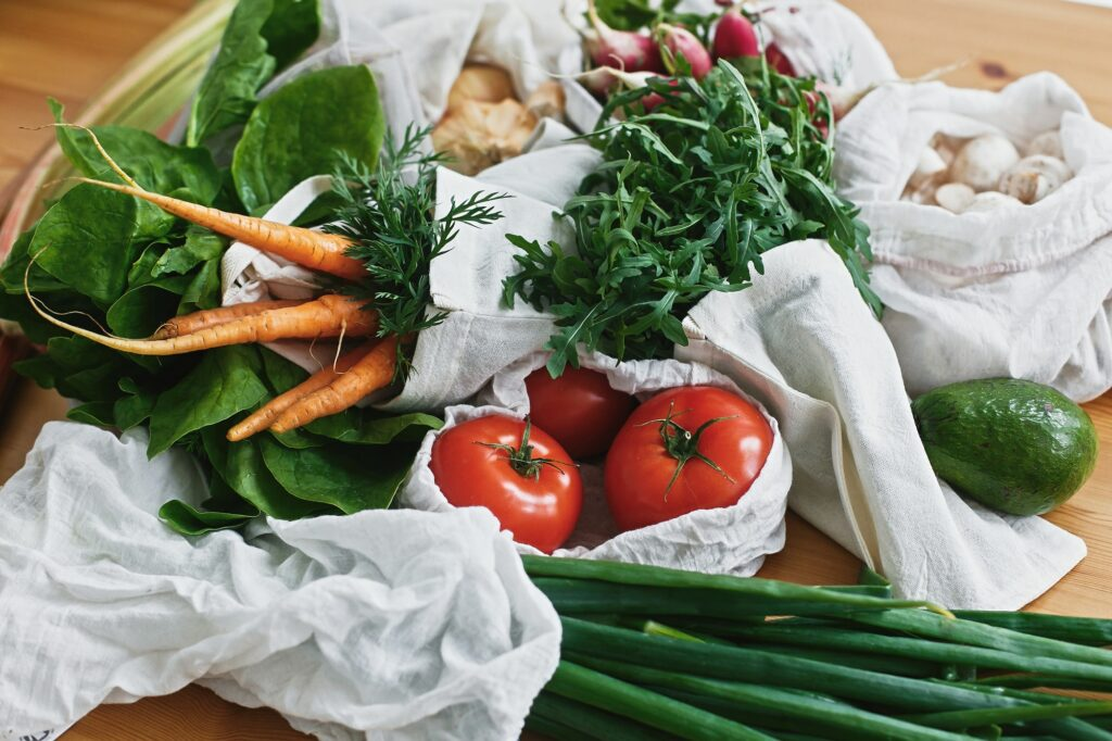 Zero waste grocery shopping concept. Reusable eco friendly bags with fresh vegetables